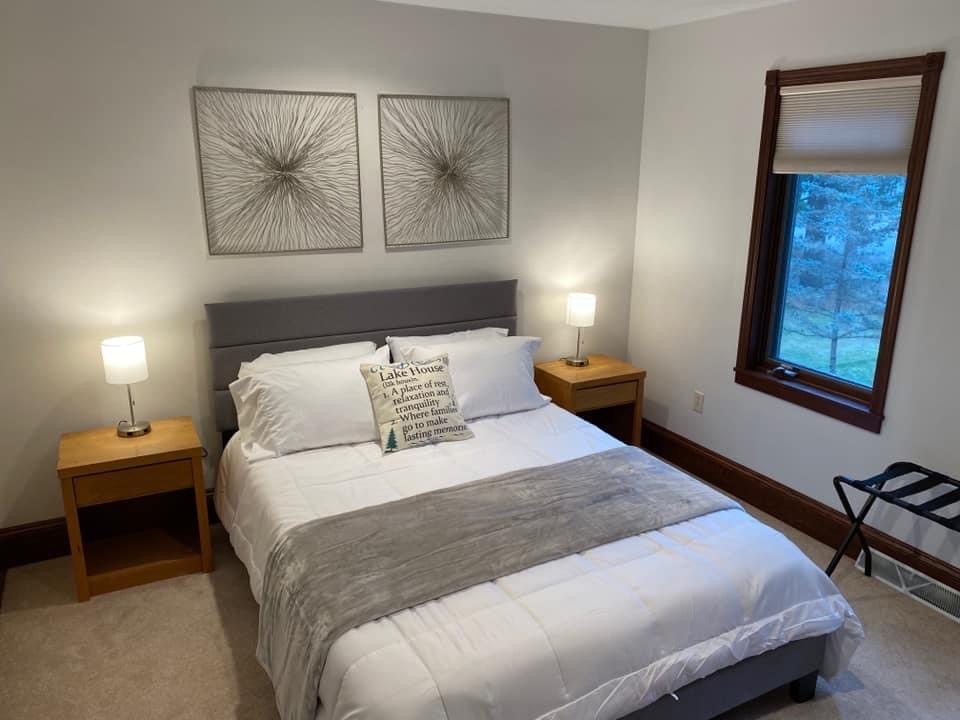 Upper bedroom #3. Queen size bed, luggage rack, closet, nightstands, lamps with USB ports.