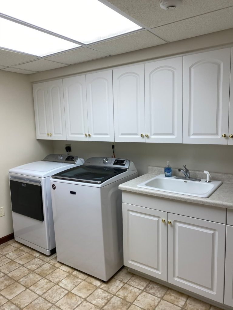 2nd laundry room with sink and plenty of storage space. NEW HIGH CAPACITY EQUIPMENT!